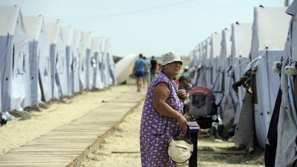 A refugee from eastern Ukraine walks in a refugee camp in Russia's Rostov region