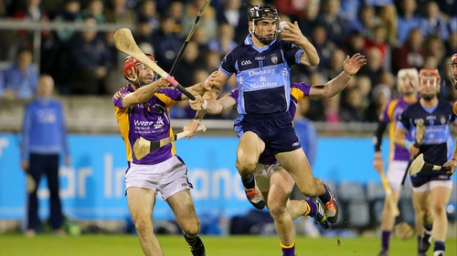 Danny Sutcliff of St Jude's gets there ahead of Crokes' Damien Kelly