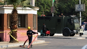 Egyptian fireman and soldiers at the scene of explosion outside Cairo University on Wednesday