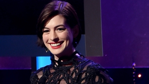Anne Hathaway happily posed for a bikini clad picture after being snapped by the paparazzi