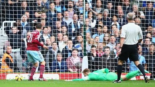 Morgan Amalfitano of West Ham United scores past Joe Hart
