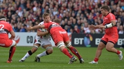 Chris Henry of Ulster is tackled by Juanne Smith of Toulon