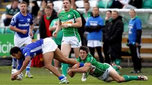Scotland's Oscar Thomas is tackled by Josh Toole of Ireland