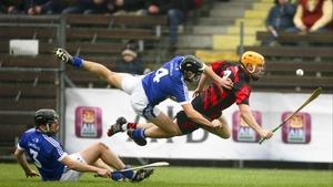 Ballygunnar's Brian O'Sullivan goes down under a challenge from David Ryan