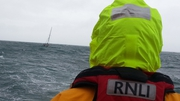 RNLI, a rescue helicopter and a local coastguard unit are involved in the search