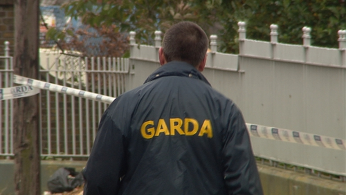 A garda presence remained at the scene today as detectives tried to establish a motive for the killing