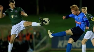 Marc Ludden of Galway (L) and UCD's Conor Cannon compete for the ball