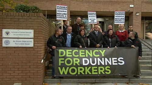 Dunnes Stores employees are seen at an October protest
