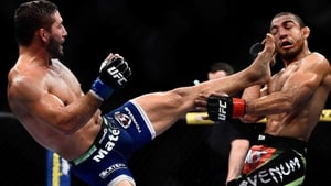 Chad Mendes of the US kicks Jose Aldo of Brazil in their UFC featherweight bout at the Maracanazinho in Brazil