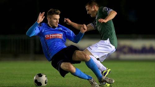 Colm Crowe of UCD tackles Galway's Jake Keegan