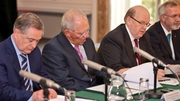 Brendan Howlin, Wolfgang Schaeuble, Michael Noonan and Werner Hoyer sign the bill (Pic: Merrion Street)