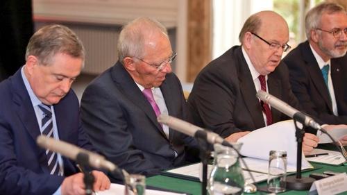 Brendan Howlin, Wolfgang Schaeuble, Michael Noonan and Werner Hoyer sign the bill (Pic: Merrion Street)