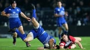 Leinster's Zane Kirchner and Nick McLennan of Edinburgh battle for the ball