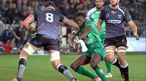 Ieuan Jones of Ospreys hands off Connacht's Niyi Adeolokun in a one-sided affair at the Liberty Stadium
