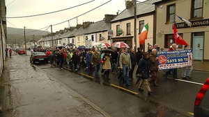 Protesters make their way through Portlaw, which is the home town of Minister of State Paudie Coffey