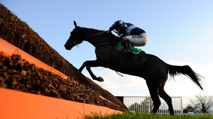 Menorah clearing the last to win Charlie Hall Steeple Chase at Wetherby