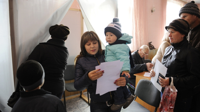 People cast their vote in the city of Sedove, Donetsk region