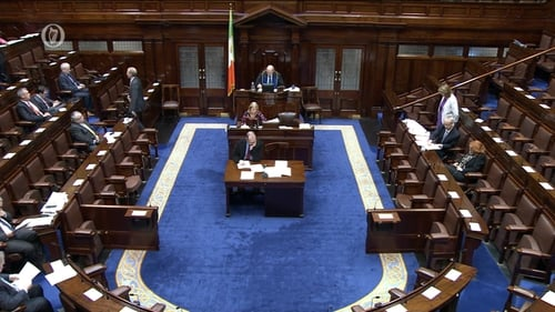 Joan Burton told the Dáil she believed a family of two parents with two young adults will pay less than €200