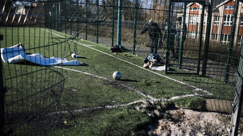 A football is seen on a playing field at a school which was shelled during fighting near Donetsk's former international airport