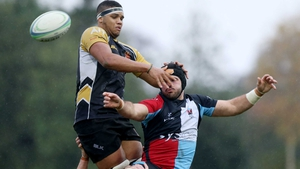 Quins Frank Taggert in action with Buccaneers Cian Romaine