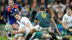 Peter O'Mahony and Robbie Henshaw try to get hands on the ball as Francois Hougaard of South Africa looks on