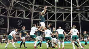 South Africa's Victor Matfield soars high in the night sky to win a line-out - an area the Boks dominated