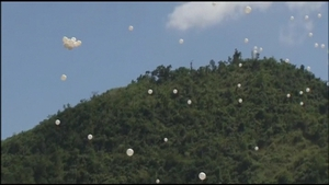Balloons were released to commemorate the dead