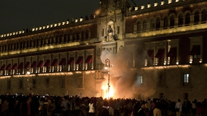 A group set fire to the wooden door of Mexican President Enrique Pena Nieto's ceremonial palace in Mexico City