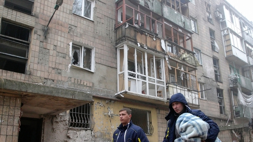 Locals walk through the streets of Donetsk, which has seen heavy shelling this weekend