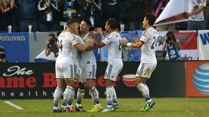 Robbie Keane receives the congratulations of his LA Galaxy team-mates in Carson