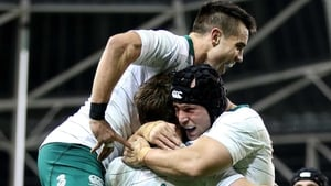 Conor Murray and Richardt Strauss congratulate Tommy Bowe on his try