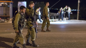 Israeli soldiers patrol close to the scene, in the West Bank, where a woman was allegedly stabbed to death