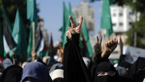 Palestinian female supporters of Hamas gesture during a rally in Gaza