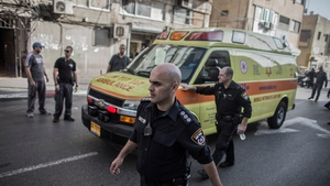 Israeli policemen escort an ambulance transporting the Palestinian who allegedly stabbed an Israeli soldier after his arrest in Tel Aviv yesterday