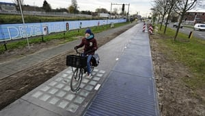 A cyclist on the SolaRoad, the first road in the world made of solar panels