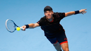 Tomas Berdych of Czech Republic plays a forehand against Marin Cilic of Croatia