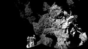 Philae is resting precariously on two out of three legs in the shadow of a cliff on the comet