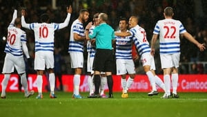 QPR players protest to referee Mike Dean as Charlie Austin's goal is disallowed during the match between Queens Park Rangers and Manchester City