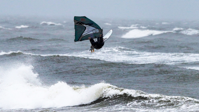 Windsurfers made the most of the strong winds in Dublin yesterday