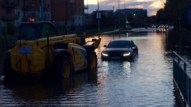 A car is towed from flood waters on Enniskerry Road in Stepaside, Dublin
