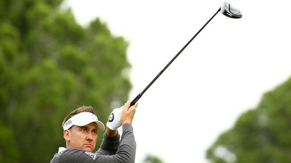 Ian Poulter tees off at the sixth during the second round