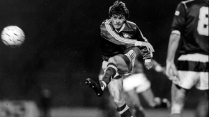 Ray Houghton has a shot on goal