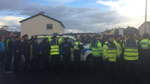 Tánaiste Joan Burton and her entourage were allegedly trapped in a car during the protest