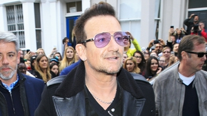 The woman who called 911 after Bono's his bike fall in New York was booed off stage at a U2 concert
