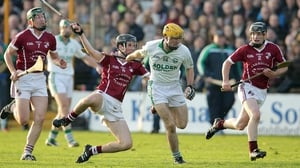 Ballyhale's Colin Fennelly escapes the chasing posse of Clara players