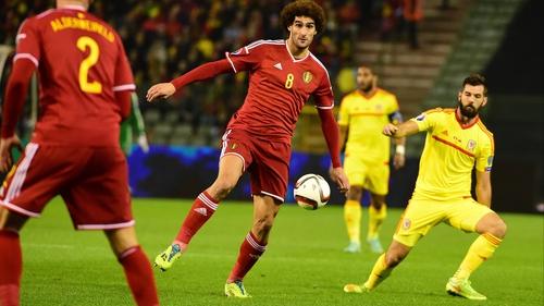 Belgium's Marouane Fellaini controls the ball as Joe Ledley looks on for Wales