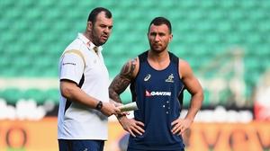 Australia coach Michael Cheika (L) with Quade Cooper