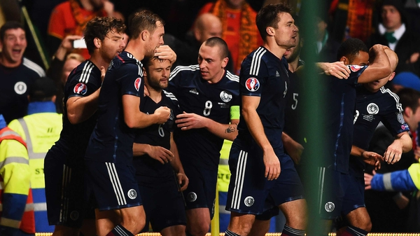 Scotland players celebrate after Shaun Maloney scored the winner in Celtic Park