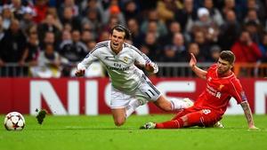 Alberto Moreno gets too close to Gareth Bale during a Champions League clash
