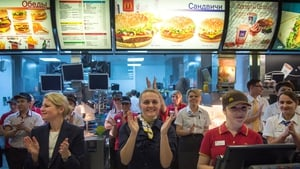 McDonald's staff in Russia celebrate after the fast-food restaurant reopened after a hygiene probe